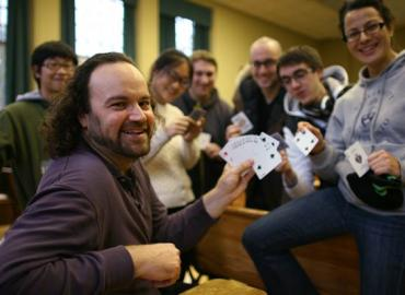 Jeffrey Rosenthal with students holding cards and smiling