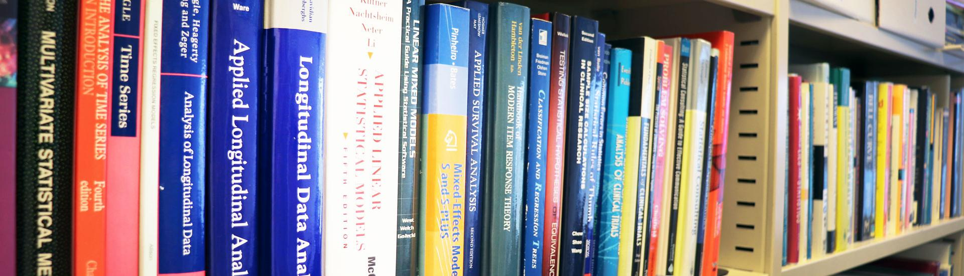 Image of statistical sciences books on a shelf